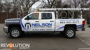 roofing company truck wraps creating a perfect design balance for