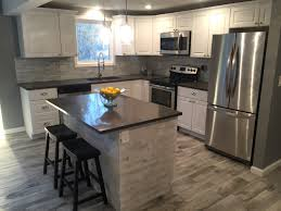 modern kitchen gleaming white cabinetry quartz counter top modern kitchen gleaming white cabinetry quartz counter top stainless steel appliances