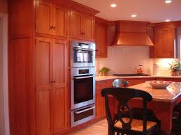 custom cherry cabinets in a simple mission like style by odhner