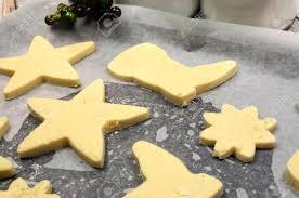 baking homemade christmas shortbread cookie biscuits in reindeer