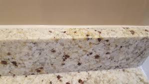 caulking kitchen backsplash granite installer installed backsplash and left 1 2 inch caulk line