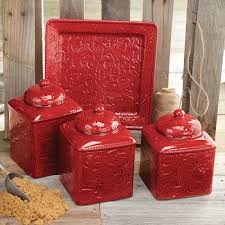 red kitchen canister set and platter