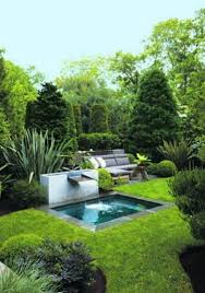 modern backyard waterfalls over plunge pool modern backyard