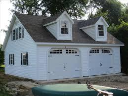 2 car 2 story modular garage aframe metal roof with cupola and