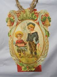 antique scrap tinsel ornament with two boys and forget