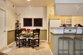 next kitchen furniture dining table next to kitchen area stock photo picture and royalty