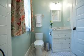 traditional powder room with corian counters u0026 flat panel cabinets