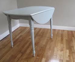 Round Drop Leaf Kitchen Table UHURU FURNITURE COLLECTIBLES - Round drop leaf kitchen table