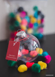 a colorful pom pom ornament u2014 savannah smiled
