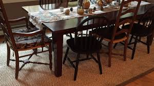 dark wood floors kitchen traditional with area rugs brass pendant