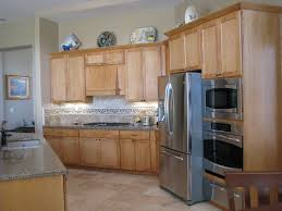 grey quartz countertops and natural wood kitchen cabinets with