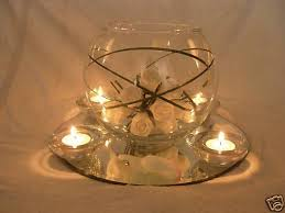 centerpiece bowls for tables love the mirror at the bottom with white flower petals inside the