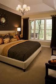 gorgeous chocolate brown master bedroom with dark storage fluffy