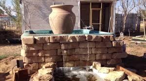 tub water fountain pond into backyard river youtube