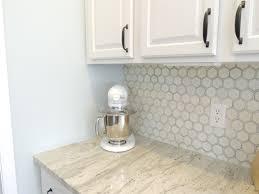 white kitchen cabinets with hexagon backsplash rockford kitchen painted cabinets river white granite