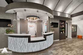 curved and open reception desk dental office design by arminco