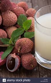 lychee juice lychee juice with fresh fruits on wooden background stock photo