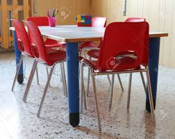 Small School Desk Interiot Classroom Of A Kindergarten With Chairs And Small