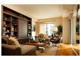 neutral living room built in bookshelves bookcase styling ceiling
