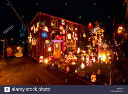 england christmas decorations on outside of house and garden stock