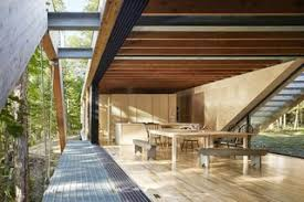 a unique home in the canadian forest that doubles as a bridge dwell