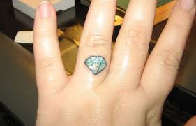 Does The Wedding Band Go Before The Engagement Ring by 10 Great Wedding And Engagement Ring Tattoo Ideas Tatring