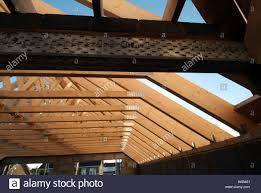 detached house under construction showing roof truss rafters and