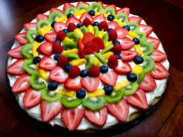 fruit pizza on a giant sugar cookie