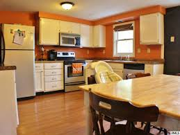 white kitchen cabinets orange walls jackson michigan real estate orange kitchen walls kitchen