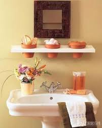 bathroom organization ideas for small bathrooms shelves instead of artwork above the toilet in a small bathroom