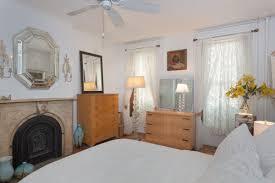 italianate townhouse with stunning sun room and lush backyard asks