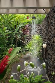 tropical landscape yard with pathway fence black lava rock wall