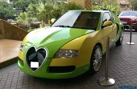 yellow and silver bugatti rahim singh modifies his honda into a bugatti veyron replica