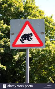 road sign warning to beware of frogs and toads crossing at