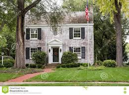 colonial house white brick georgian colonial house with flagpole stock photo