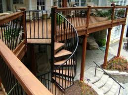 model staircase outdoor deck with white railing and staircase