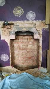advice needed on opening a fireplace which has an odd lintel