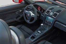 porsche cayman review 2015 2015 porsche cayman gts boxster gts track drive motor trend