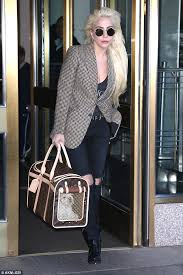 gaga carries new pup around in 2 600 louis vuitton bag