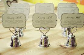 wedding giveaways silver heart bell place card holders photo holders wedding