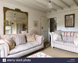 Two Sofa Living Room White Sitting Room With Beamed Ceiling Two Sofas And Large Mirror