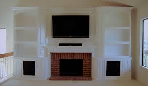 custom white cabinets around fireplace