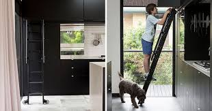 Matte Black Kitchen Cabinets This Kitchen Has A Rolling Ladder To Reach The Cabinets