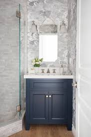 Contemporary Bathroom Wall Sconces Blue Washstand With Arched Mirror And White Glass Bell Wall