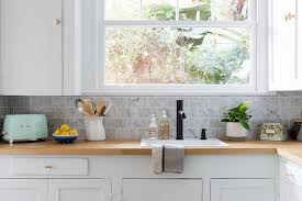 kitchen with white cabinets and wood countertops blond wood countertops with white shaker cabinets