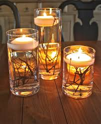 bringing the outdoors in candles vases and center pieces
