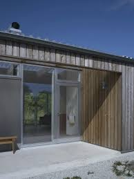 Metal House Designs Small Swedish House Made From Boards And Corrugated Metal