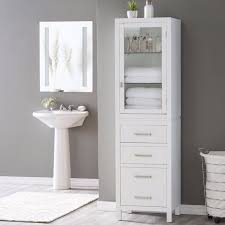 white tall bathroom cabinet with traditional bathroom mirror