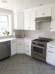 gray u0026 white kitchen with subway tile backsplash in tusk