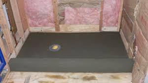 Basement Flooring Tiles With A Built In Vapor Barrier How To Build A Shower Pan